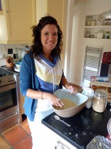 Au pair making a cake