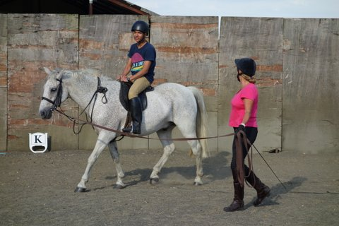 Spanish student having a riding lesson at Glapthorn Riding Stables, Oundle